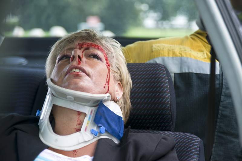 woman with injured neck from car accident